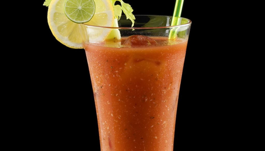 Bloody mary cocktail isolated on a black background